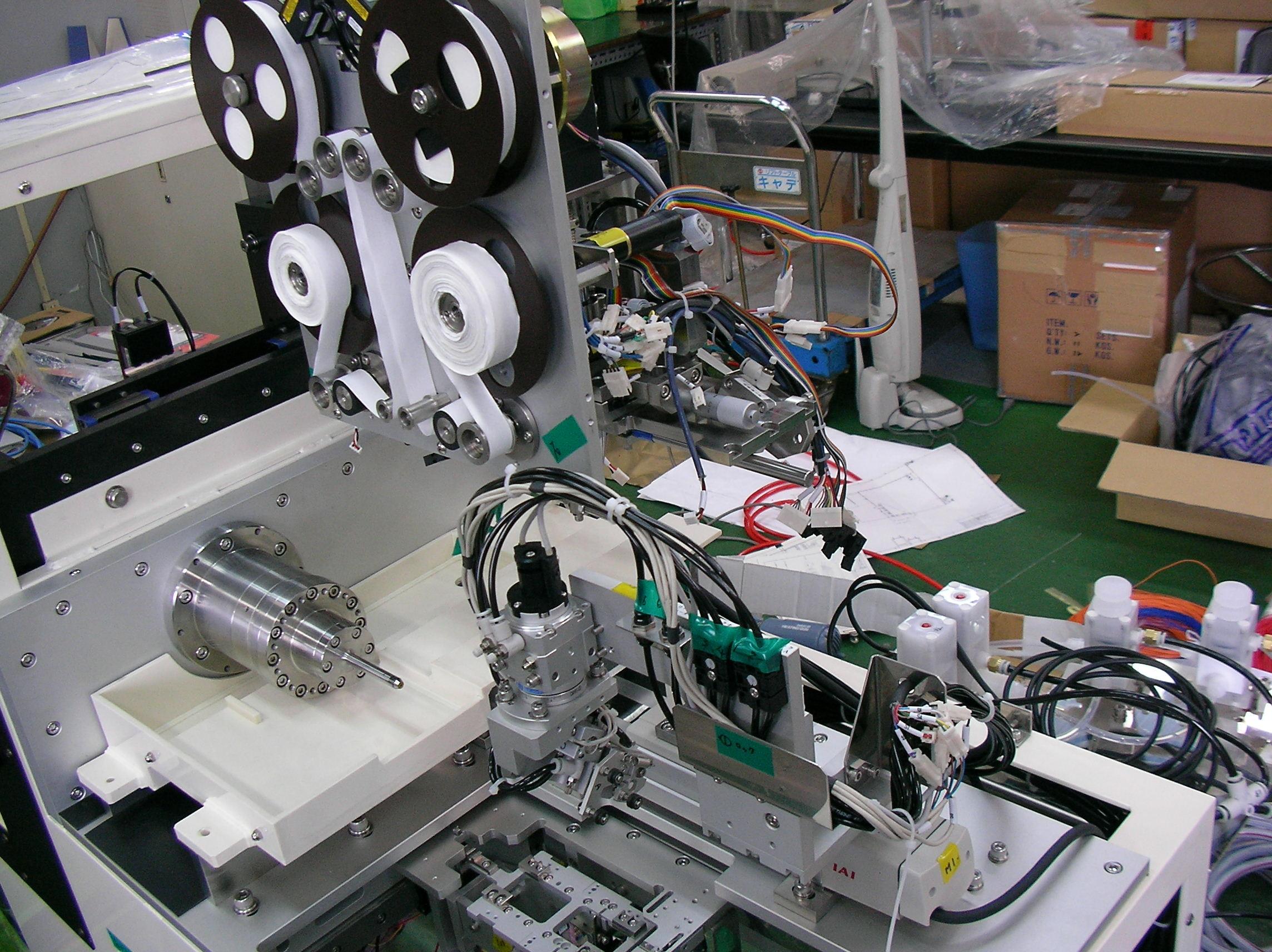 ハードディスク表面研磨装置